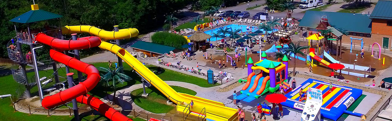 Aerial photo of slides, pools, jump pad, water wars and more at Yogi Bears Jellystone Park at Mill Run near the Laurel Highlands in PA