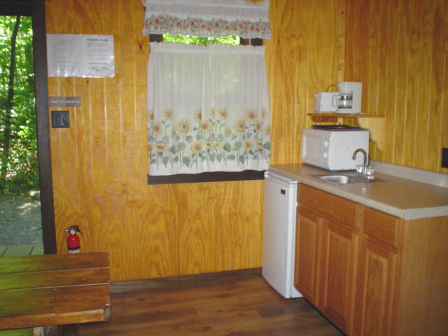 kitchen at boo boo pet friendly cabin near pittsburgh at jellystone mill run in pa