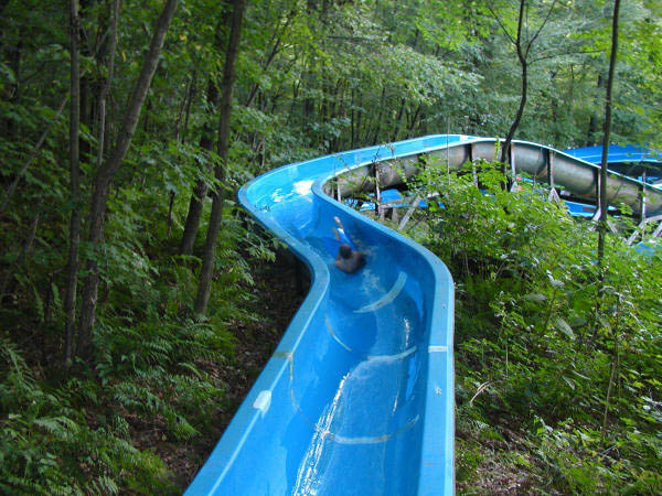 boy sliding down one of our lower water slides