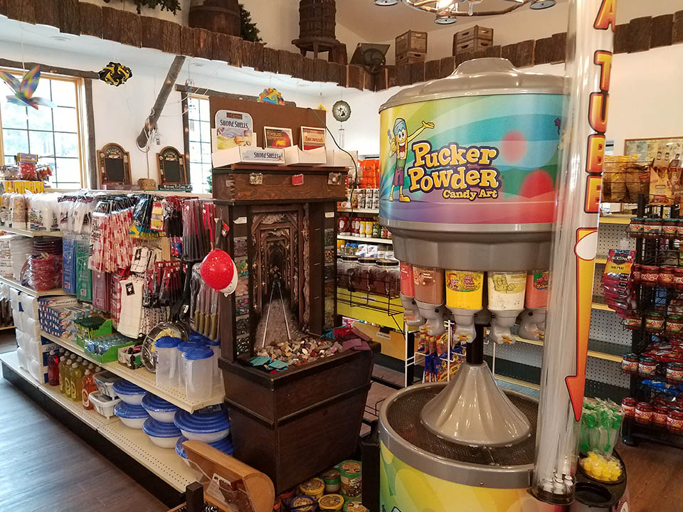 photo of items in the store including kitchen items and pucker powder candy